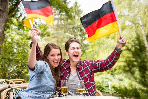 German Couple Cheering and Celebrating Germany