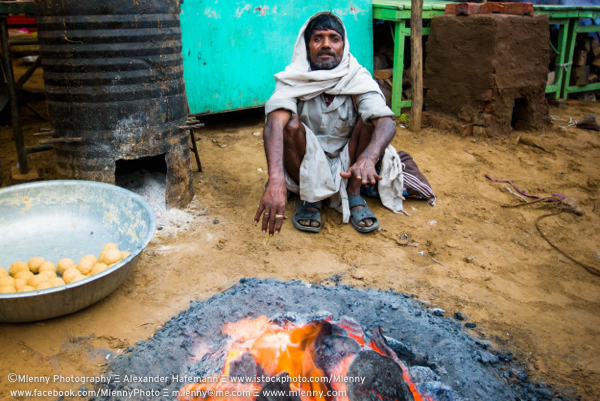 Indian Man at Fireplace Real People Rajasthan, India