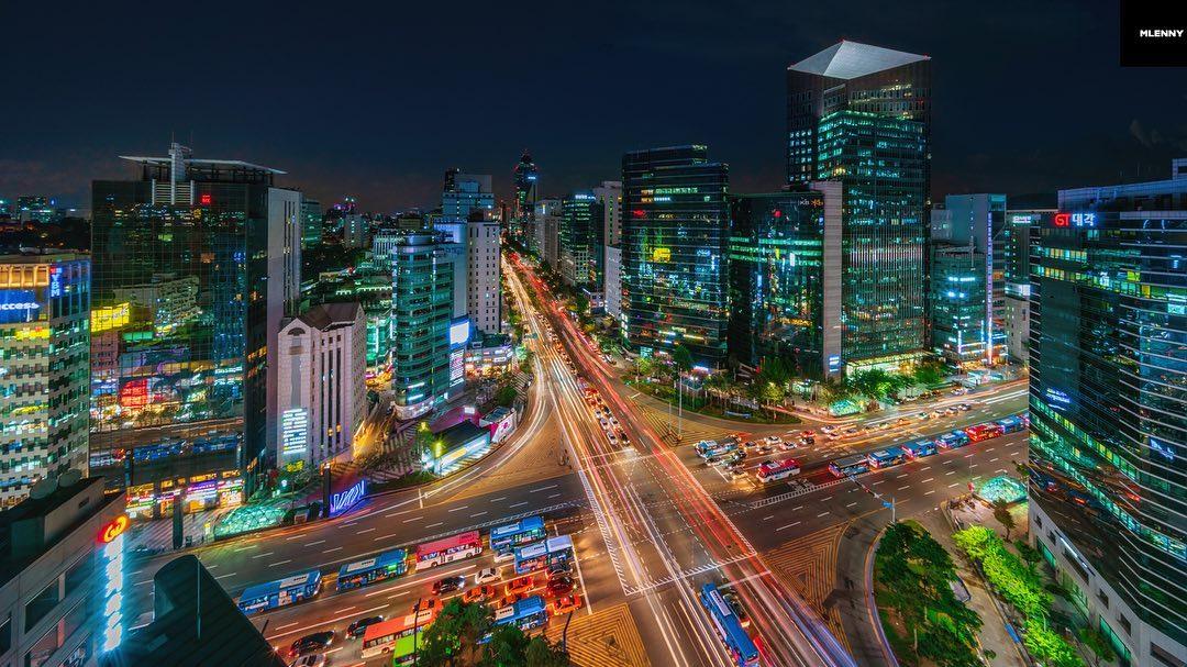 Night over illuminated Seoul - South Korea.  Panorama View towards downtown Gangnam Illuminated Cityscape at Night