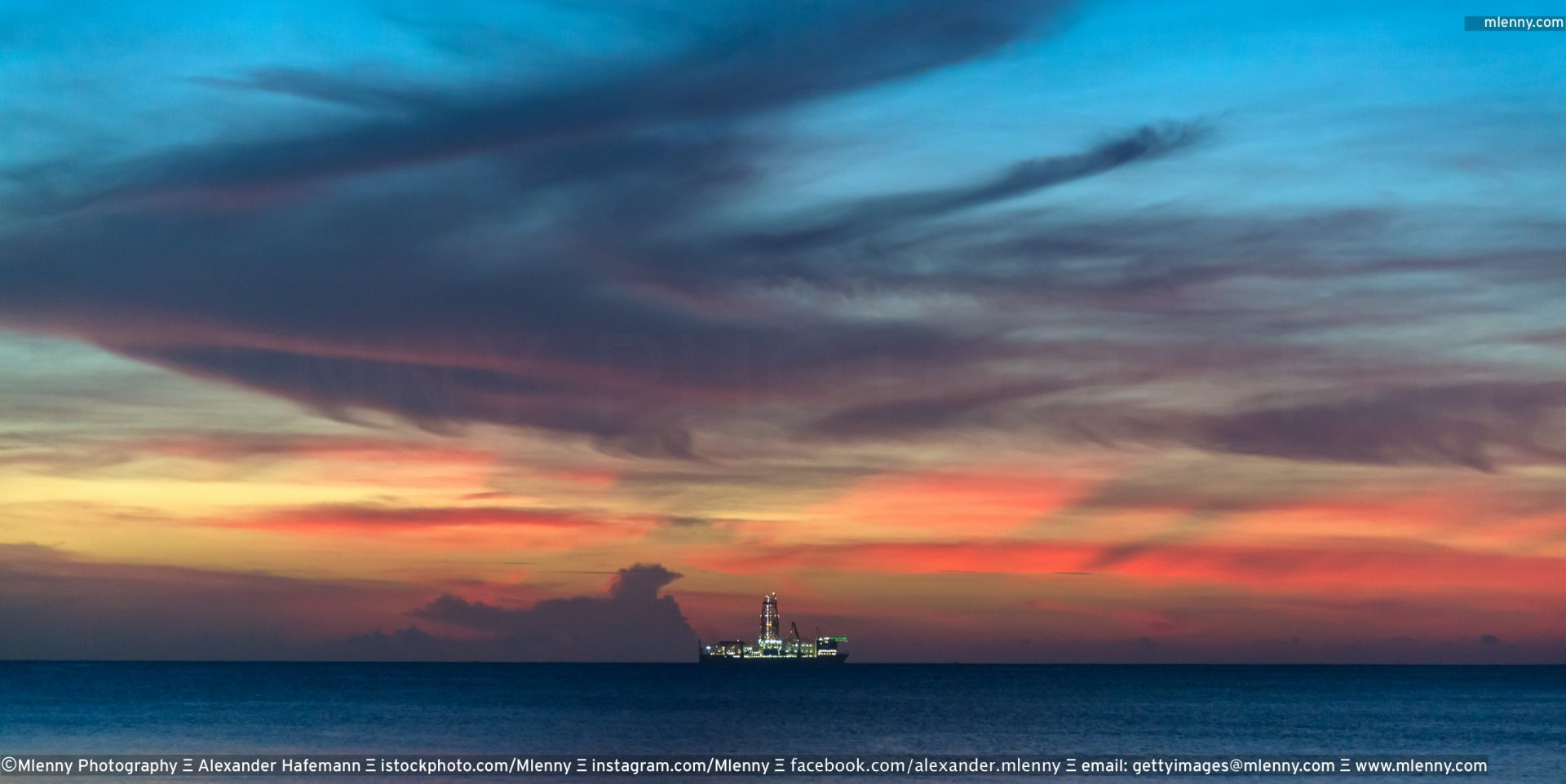 Drillship under colorful twilight skyscape
