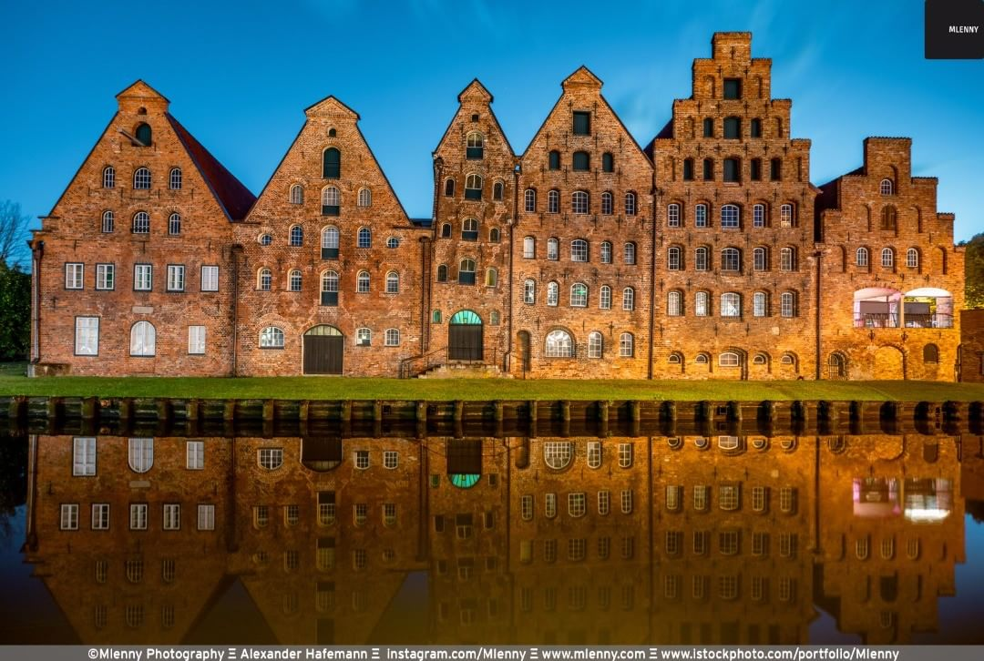 Die Lübecker Salzspeicher - Historic Salt Storehouses - built between the years 1579-1745 in Lübeck mirroring in the Obertrave river at twilight. @shootuploadrepeat